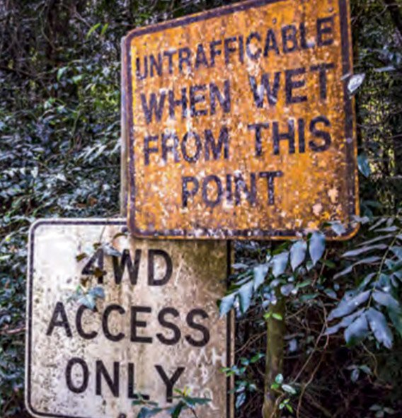 """Signs on the track that read """"Untrafficable when wet from this point"""" and """"4WD access only"""""""