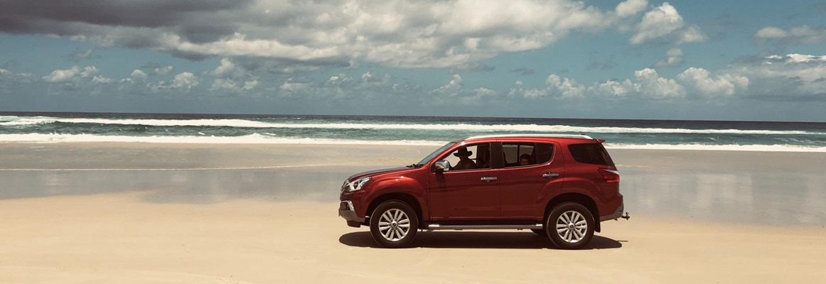MU-X driving along Moreton Island Beach