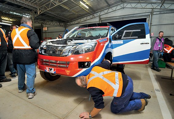 The D-MAX is checked over by the mechanics on the team