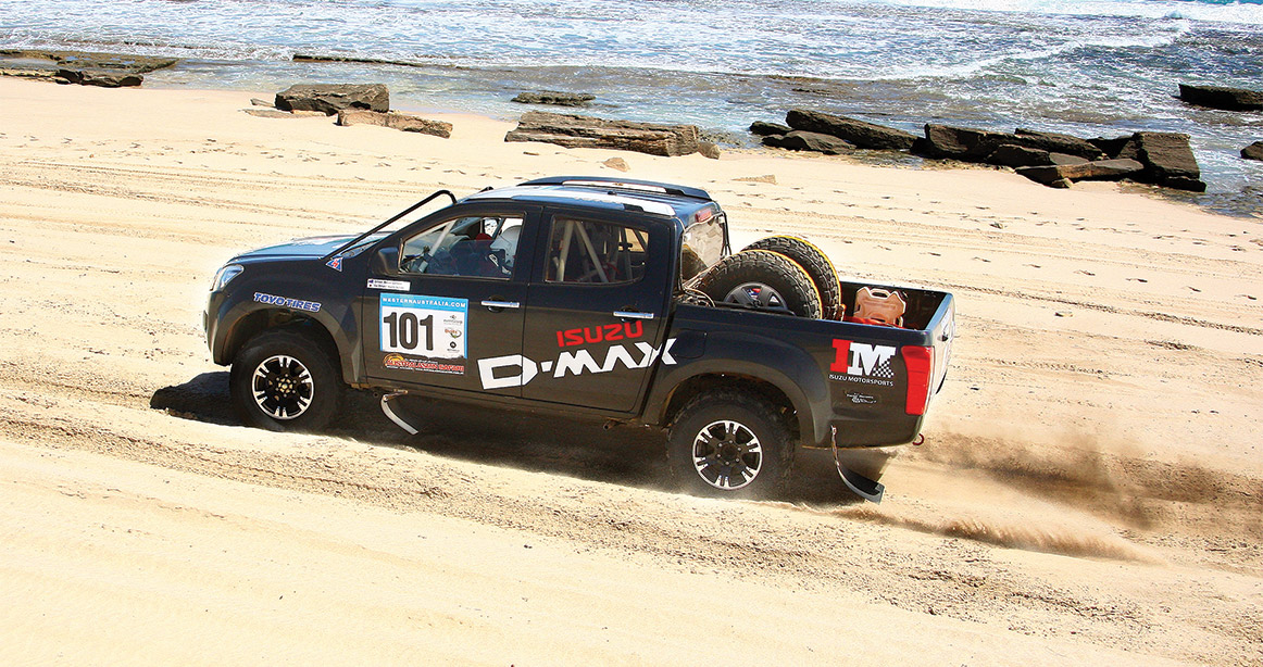 The D-MAX drives across dusty track